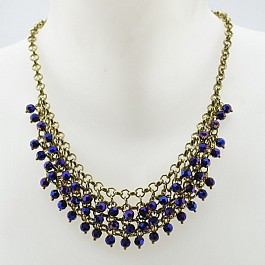 burnished-gold-necklace-with-cascading-purple-beads.jpg